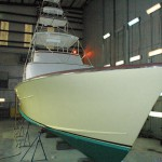 This 48' sport fishing boat, custom built by Graves, gets a custom paint job in our twin-bay, climate controlled building.